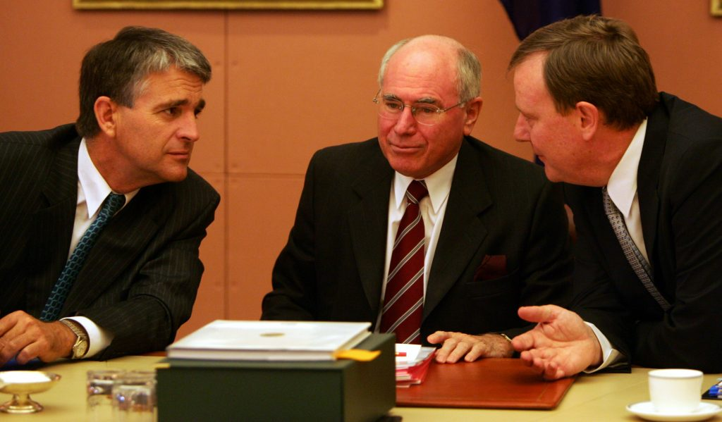 Deputy Prime Minister John Anderson Prime Minister and Treasurer Peter Costello in the Cabinet room in Parliament House in Canberra at a Cabinet meeting before the first sitting day of the fourth Howard Parliament on 15 November 2004 SMH NEWS Picture by ANDREW TAYLOR